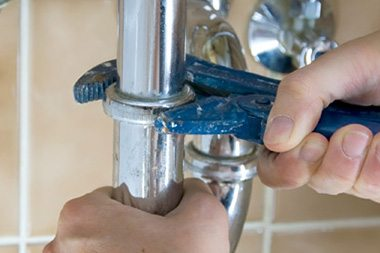 plumber fixing a sink drain